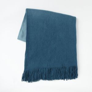This dark blue throw is perfect for curling up on the couch
