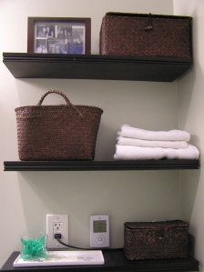Baskets on the shelves hide ugly chargers. I also put the thermostat for the heated floors and the outlet ABOVE the first shelf, making them easier to cover up--and less distance for cords to have to stretch.