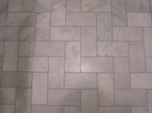 The bathroom floor is marble subway tile installed in a straight herringbone. Just enough interest without making the small footprint too busy.