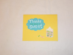 Martha Stewart candy stickers have a little dimensional but are flat enough to mail. The lettering is on a shape I cut with my Cuttlebug.
