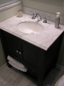 Between the open shelf on the bottom of the vanity and the cabinet, it has a ton of storage.